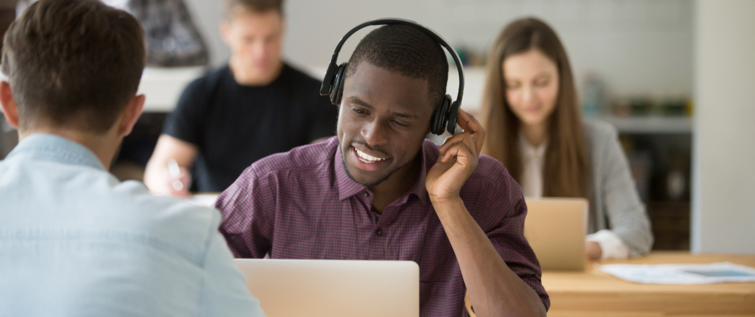 sales rep with laptop cold calling in an office